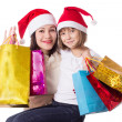 Happy mother and daughter on Christmas shopping — Foto de Stock