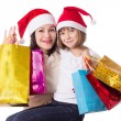 Happy mother and daughter on Christmas shopping — ストック写真