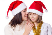 Mother and daughter sharing each other secrets on Christmas Eve — Stock Photo