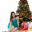 Pretty girl in fancy dress under Christmas tree — Stock Photo #35900181