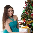 Pretty girl in fancy dress under Christmas tree — Foto Stock