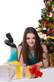 Teenage girl in fancy dress under Christmas tree — Stock Photo