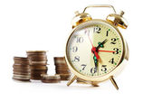 Alarm clock and coins — Foto Stock