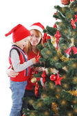 Mother and son under Christmas tree — Stock Photo