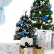 Christmas tree decorated with blue ornaments and presents — Stock Photo