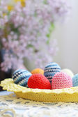 Handmade knitted Easter eggs and lilac flower — Stock Photo