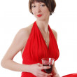 Elegant woman in dress with red glass of wine — Stock Photo