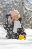 Girl having fun in snowy park — Stock Photo