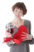 Woman with glass of red wine and heart — Stock Photo