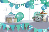 Blue and green colored birthday party table — Stock Photo