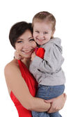 Happy mother and little daughter hugging — Stock Photo