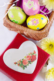 Easter decoration with eggs, flowers and heart — Stock Photo
