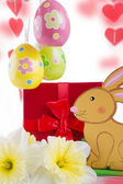 Easter decoration with rabbit, narcissus and eggs — Stock Photo