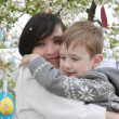 Mother and son in blooming garden decorating for Easter — Stock Photo