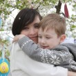Mother and son in blooming garden decorating for Easter — Stock Photo #45892193
