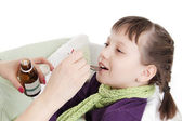 Mothre giving spoon dose of medicine to child — Stock Photo
