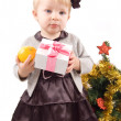 Little girl with Christmas tree and gifts — Stock Photo #7648617