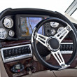 Instrument panel and steering wheel of a motor boat cockpit — Stock Photo