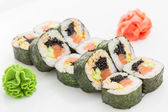 Japanese cuisine - sushi and rolls — Stock Photo