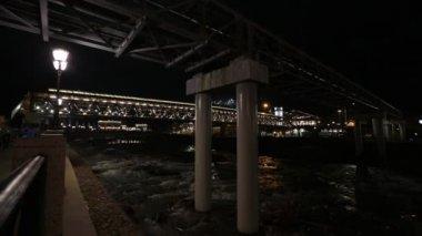 New bridge, evening, flowing river — Video Stock