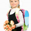 First grader girl in school uniform with bouquet of flowers an — Foto Stock #14929025