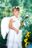 Sad girl I angel wings with a pink rose — Stock Photo