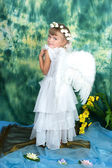 Cute girl with angel wings is back — Stock Photo
