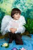 Handsome boy with angel wings — Stock Photo