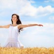 Young woman having joy in wheat field — Stock Photo