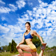 Young woman stretching before running — Stock Photo #12630413