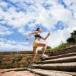 Woman jogging in nature — Stock fotografie