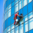 Window washer cleaning windows — Stock Photo