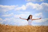 Woman enjoying in wheat field — Stock Photo