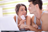 Young couple shopping over internet — Stock Photo