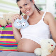 Pregnant woman has bought things for your baby — Stock Photo #13368234