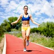 Woman jumping rope - Stock Photo