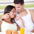Affectionate couple having breakfast in bed — Stock Photo #13369577