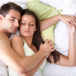 Couple sleeping on the bed — Stock Photo #13369635