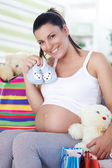 Pregnant woman has bought things for your baby — Stock Photo