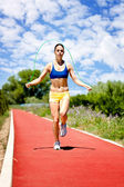 Woman jumping rope — Stock Photo