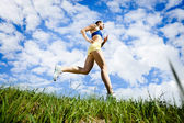Young woman running outdoor — Stock Photo