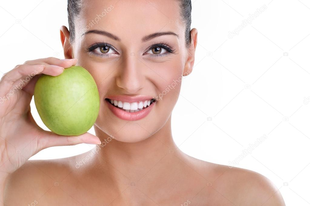 young woman with perfect healthy smiling holding green apple — Stock Photo #13368544