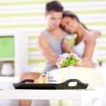 Happy couple having breakfast in bed — Stock Photo