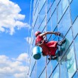 Window washer at work - Stock Photo
