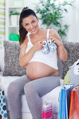 Pregnant woman at home after shopping — Stock Photo