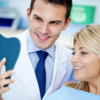 Stock Photo: Dentist and satisfied patient with white teeth