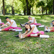 Women doing stretching exercise — Stock Photo