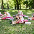 Women doing stretching exercise — Stock Photo #14555061
