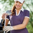 Golfer with golf equipment — Stock Photo #14555287