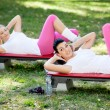 Women exercise in park - Stock Photo